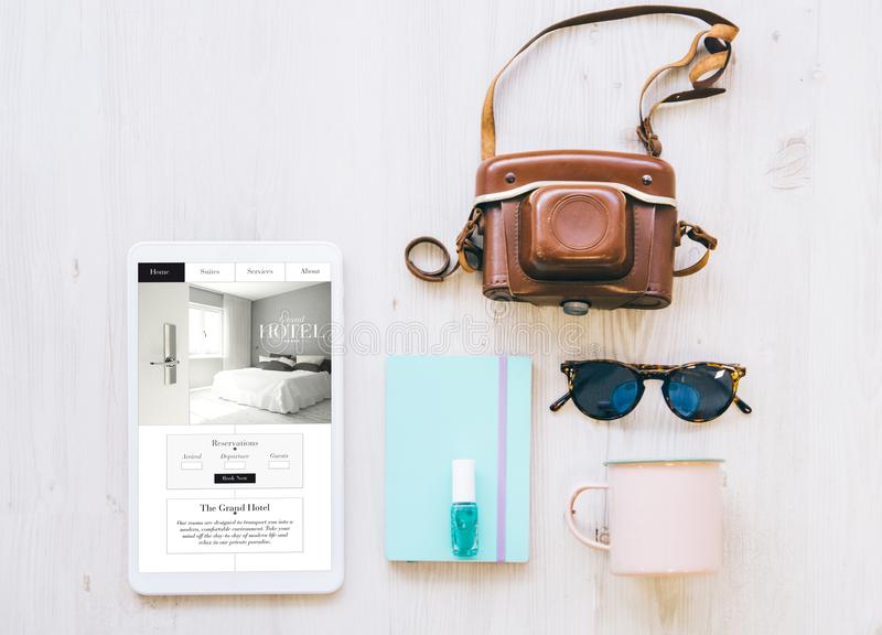 travel essentials and hotel website on tablet royalty free stock photos