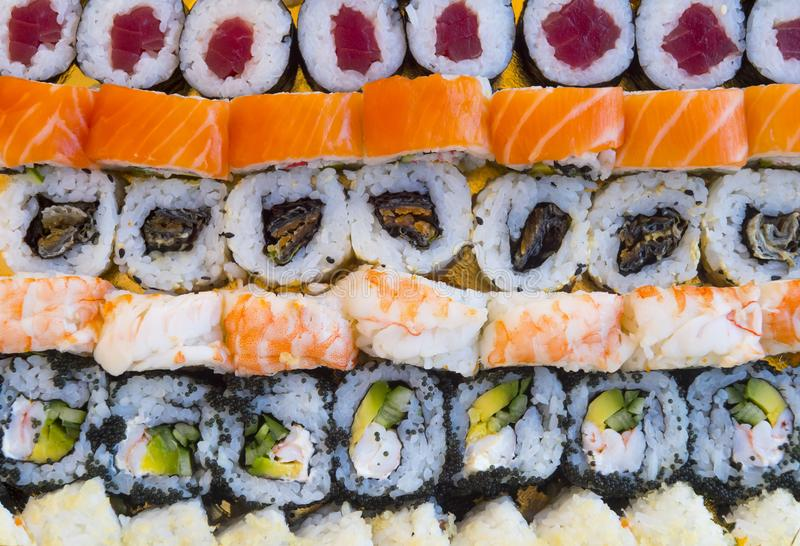 Overhead japanese sushi food. Maki ands rolls with tuna, salmon, shrimp, crab and avocado. Top view of assorted sushi, all you can stock image