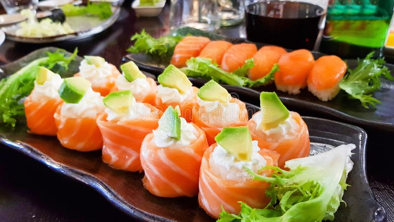 Overhead japanese sushi food.  rolls with salmon and avocado, all you can eat menu, Sushi roll japanese food in restaurant stock image