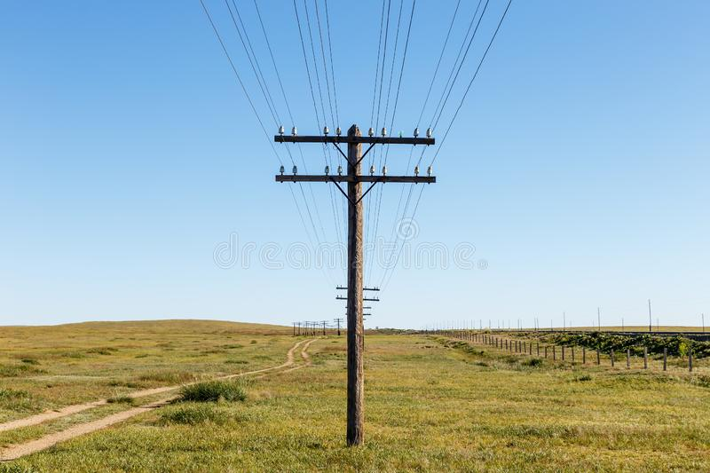 Overhead line on wooden supports in the Mongolian steppe royalty free stock image