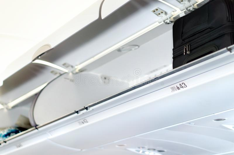 Overhead locker and compartment for baggage in airplane. royalty free stock photos