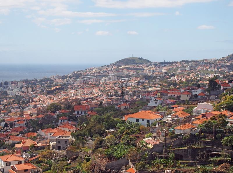 Overhead panoramic view of the city of funchal in madeira with roofs and landmarks of the city visible in front of the sea stock photo