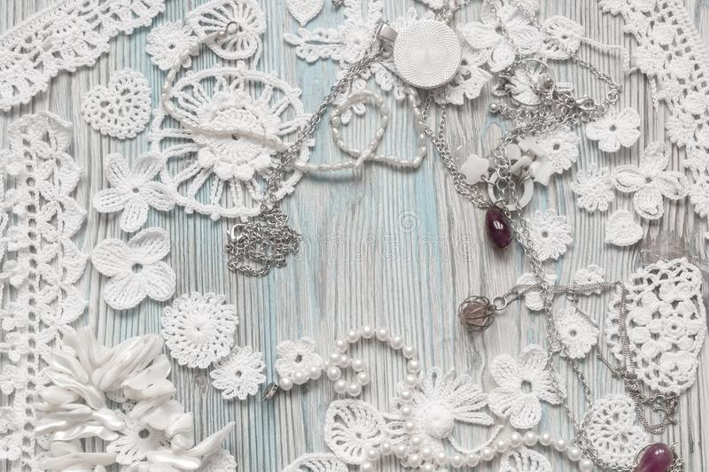 An overhead photo of cotton creative Irish crochet lace white flowers and pearls. Handmade knitted Easter, Christmas, Valentine stock photography