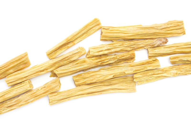 An overhead photo of dry Korean soy asparagus isolated on white. Dry Tofu skin or yuba, bean curd skin. Soy milk meal for Chinese. And Japanese cuisine royalty free stock photography