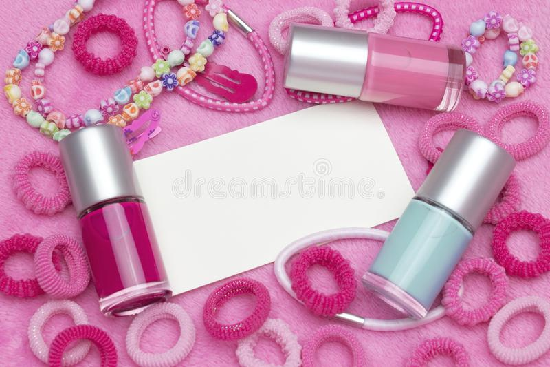 An overhead photo of little girl accessories, lifestyle set. Headband and nail polish. A group of girlish teenager accessories. A royalty free stock images