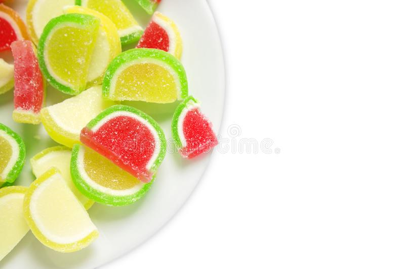 An overhead photo of sweet tasty sugary colorful jelly marmalade. Vibrant assorted candies or sweets isolated on white background, stock images