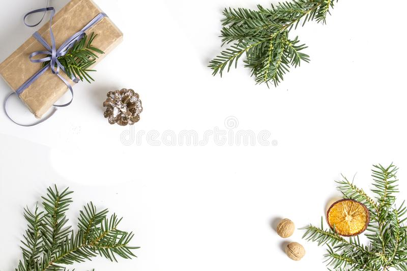 OVERHEAD RUSTIC HOMEMADE PRESENT BOX. CHRISTMAS ORNAMENTS ON WHITE BACKGROUND. MERRY CHRISTMAS. DECORATIVE ELEMENTS OVERHEAD PHOTO. BEAUTYFUL ORNAMENT TOOLS stock photo