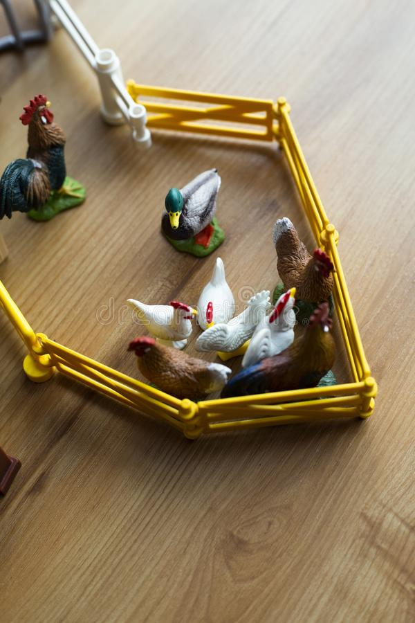 Overhead shot of animal toys on a wooden surface stock images
