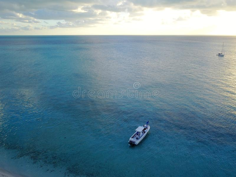 Overhead shot of a boat in the sea in Exuma. An overhead shot of a boat in the sea in Exuma stock image