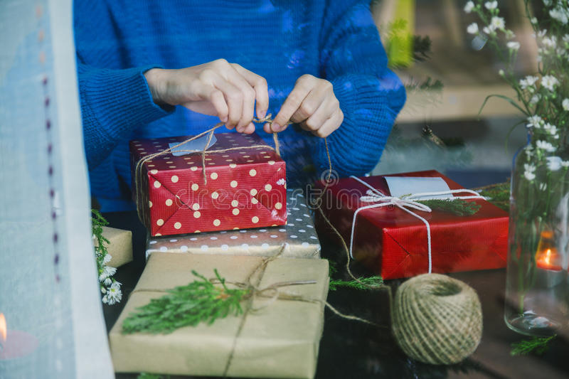 Overhead shot of Christmas presents and wrapping papers. stock photography