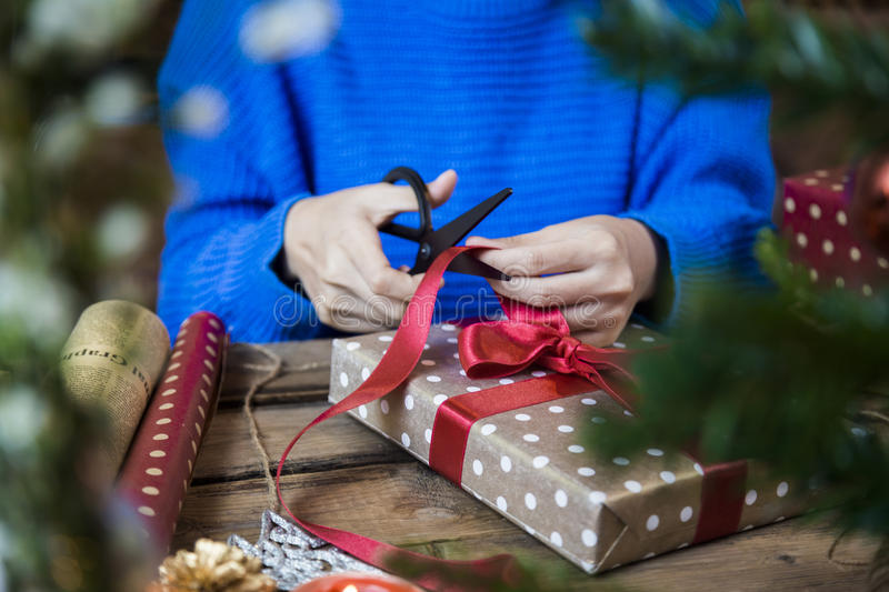 Overhead shot of Christmas presents and wrapping papers stock photos