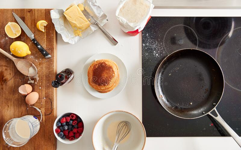 Overhead Shot Of Freshly Made Pancakes Or Crepes For Pancake Day With Maple Syrup And Berries royalty free stock photos