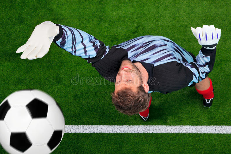 Download Overhead Shot Of A Goalkeeper Missing The Ball. Stock Photo - Image: 21968328