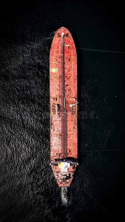 Overhead shot of a large container carrier ship on the water with beautiful textures. An overhead shot of a large container carrier ship on the water with royalty free stock photo
