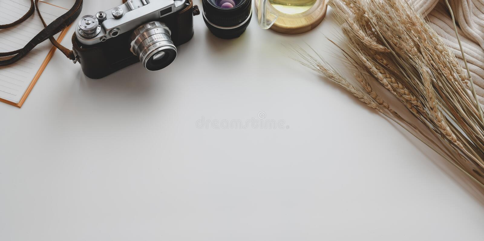 Overhead shot of minimal workplace with vintage camera and office supplies with decorations royalty free stock images