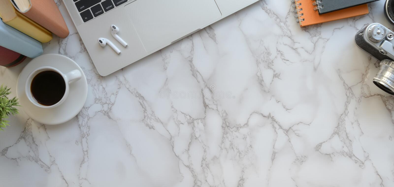 Overhead shot of modern photographer workspace with laptop computer and office accessories on marble royalty free stock images