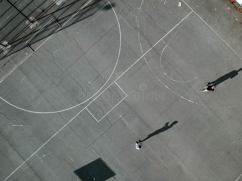 Overhead shot of people playing basketball outdoors royalty free stock image