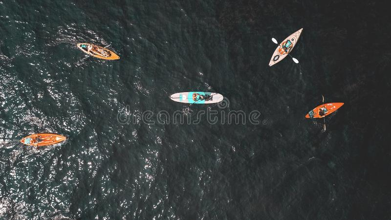 Overhead shot of people in small rowboats in the water royalty free stock images