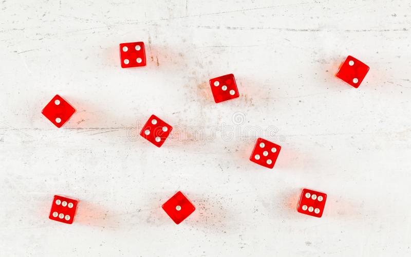 Overhead shot - red craps dices on white board showing different numbers.  royalty free stock image