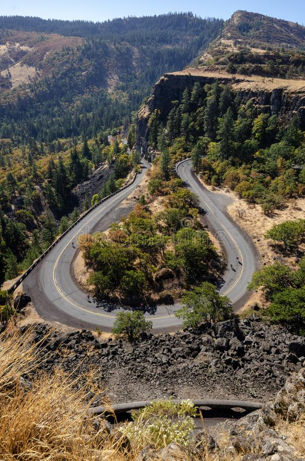 Cyclists Traveling Down a Rowena Loop royalty free stock photography