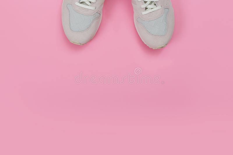Overhead Shot Of White Sneakers On colored Background royalty free stock photography