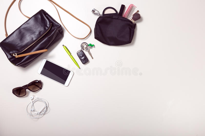Overhead shot of woman stuff isolated on white. Overhead shot of woman stuff with space on button right royalty free stock images