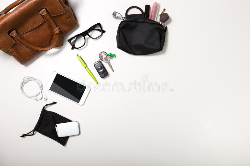 Overhead shot of woman stuff isolated on white. Overhead shot of woman stuff with space on button right royalty free stock image