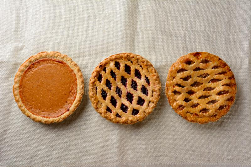 Overhead still life of fresh baked holiday pies stock photography