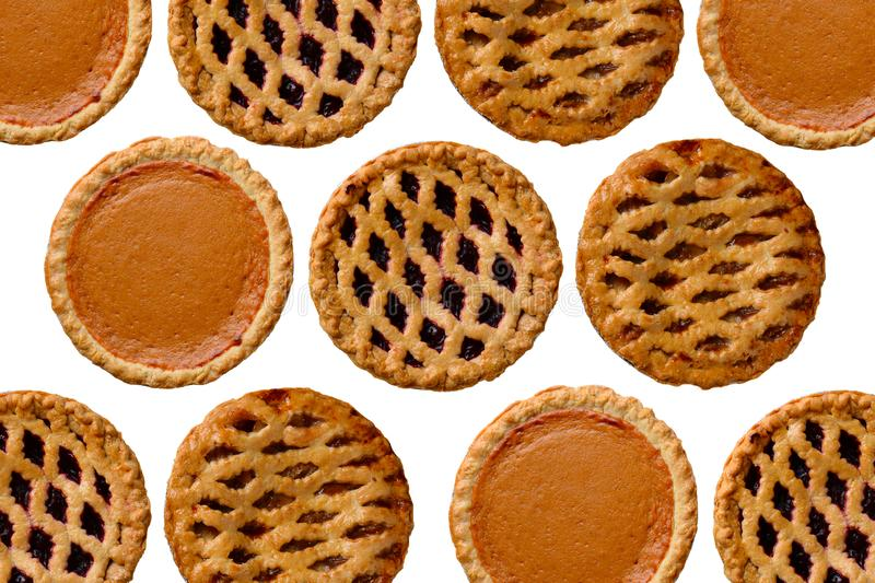 Overhead still life of fresh baked holiday pies on white royalty free stock image