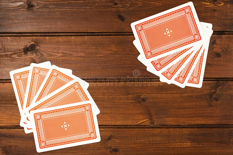 Overhead top view of playing cards. On the wooden table royalty free stock photography