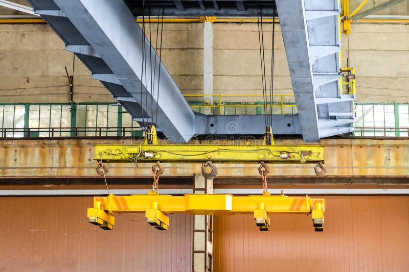 Overhead traveling crane with magnetic grippers traverse. stock images