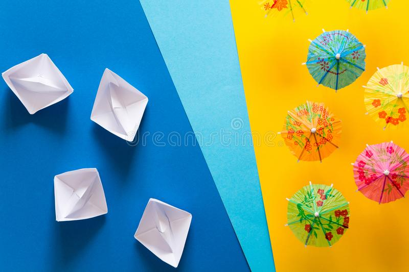 Overhead view on beach with umbrellas and sea with boats. Sea travel and summer vacation minimal concept. stock photos