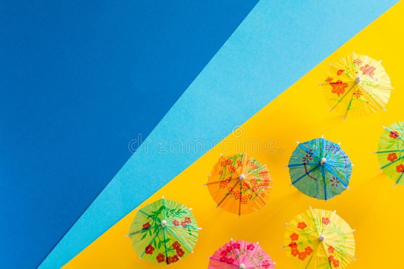 Overhead view on beach with umbrellas and sea with boats. Sea travel and summer vacation minimal concept. Paper origami royalty free stock photography