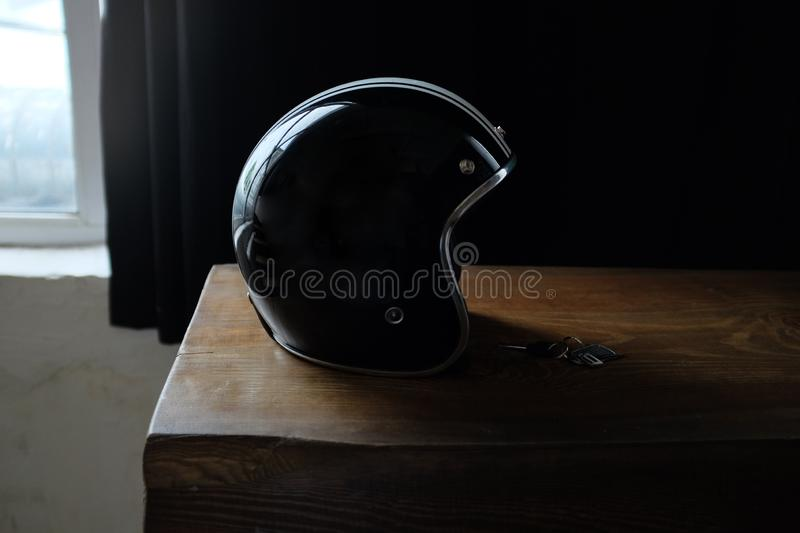 Overhead view of biker accessories placed on rustic wooden table. Items included motorcycle helmet, gloves, keys,. Motorcycle stock photos