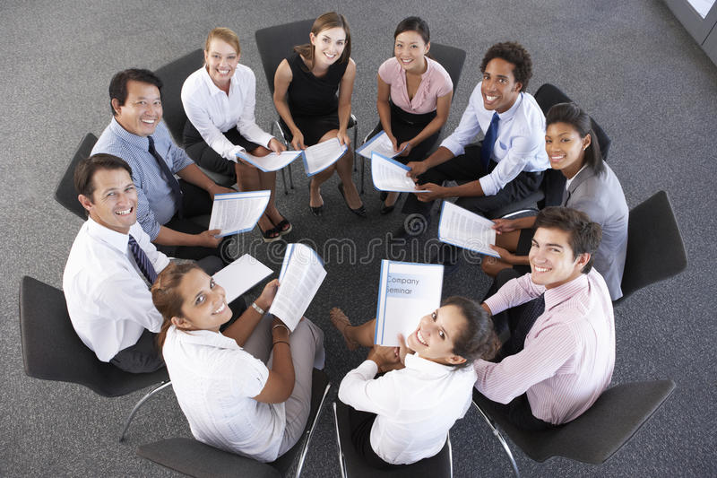Overhead View Of Businesspeople Seated In Circle At Company Seminar royalty free stock image