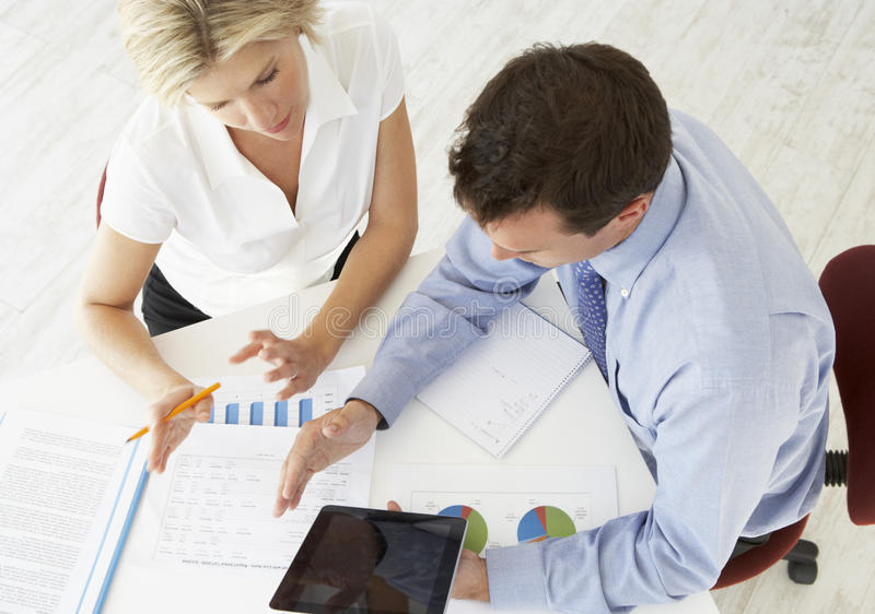 Overhead View Of Businesswoman And Businessman Working At Desk Together royalty free stock photos