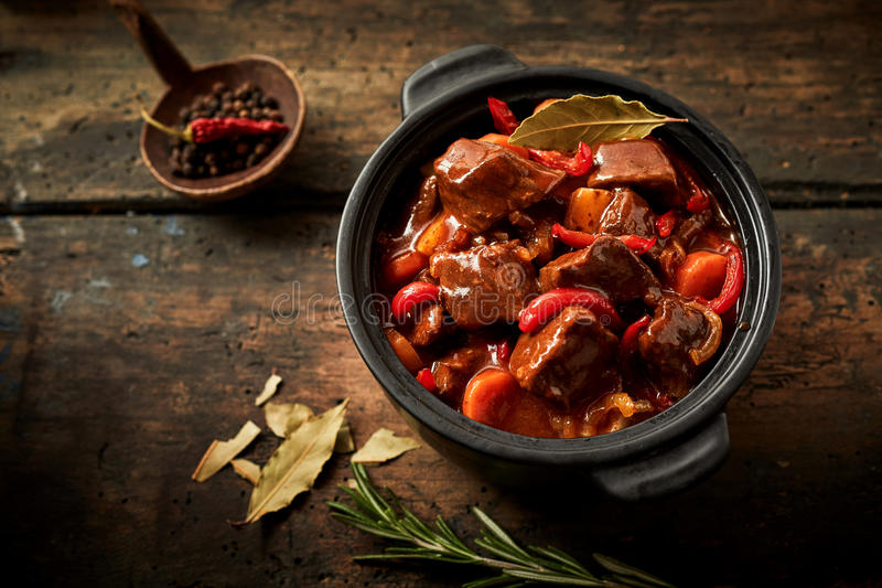 Overhead view of casserole full of hungarian goulash stock photography