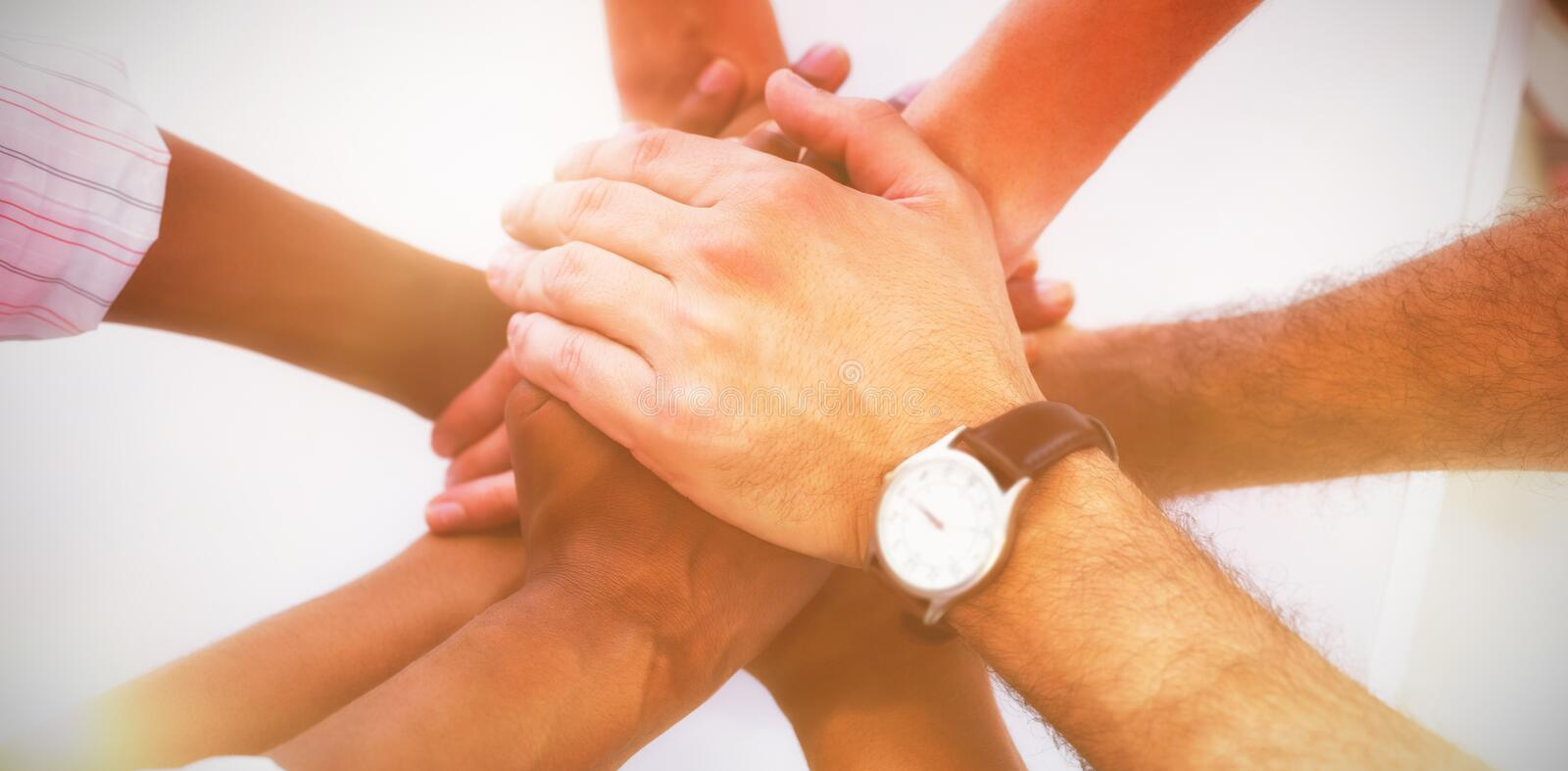 Overhead view of colleagues stacking hands royalty free stock images