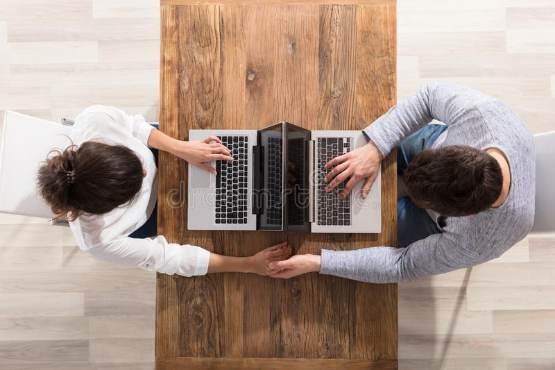 Overhead View Of Couple Using Laptop royalty free stock images