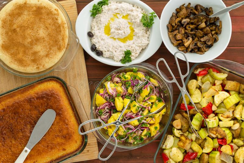 Overhead view of family meal set on picnic table stock photography