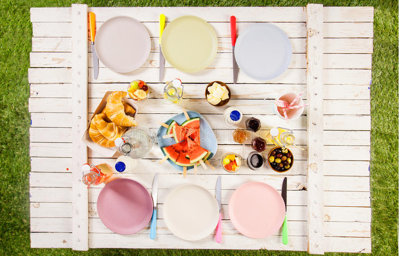Overhead view of food on a summer picnic table stock image