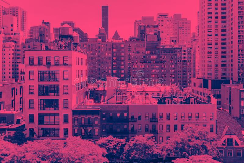 Overhead view of historic buildings in Midtown Manhattan New York City in pink. Overhead view of historic buildings in Midtown Manhattan New York City with pink stock photography