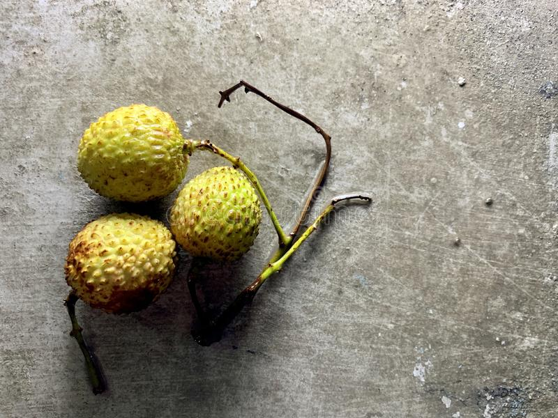 Overhead view of lychees fruit on a rustic background,Healthy food Photography stock photography