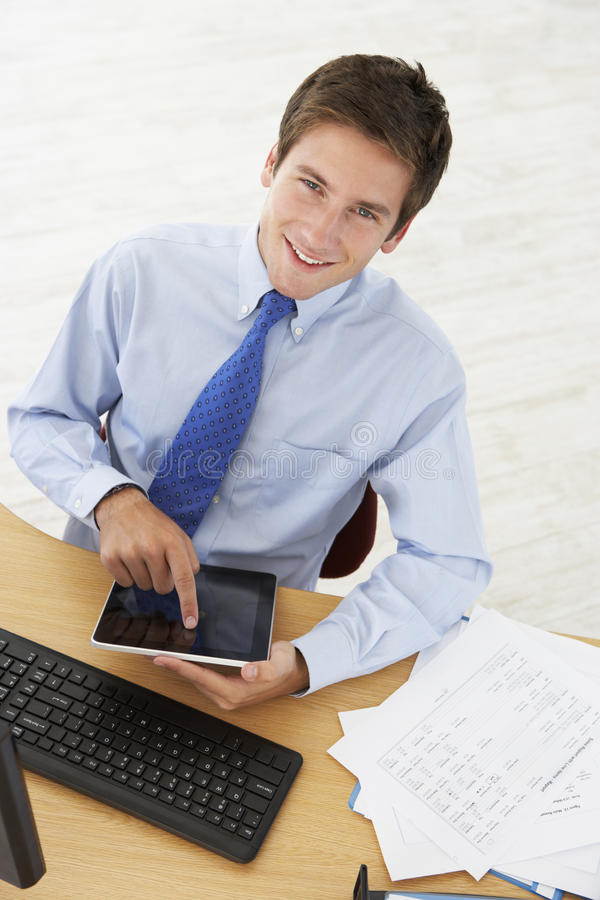 Overhead View Of Man Working At Desk Using Digital Tablet royalty free stock images