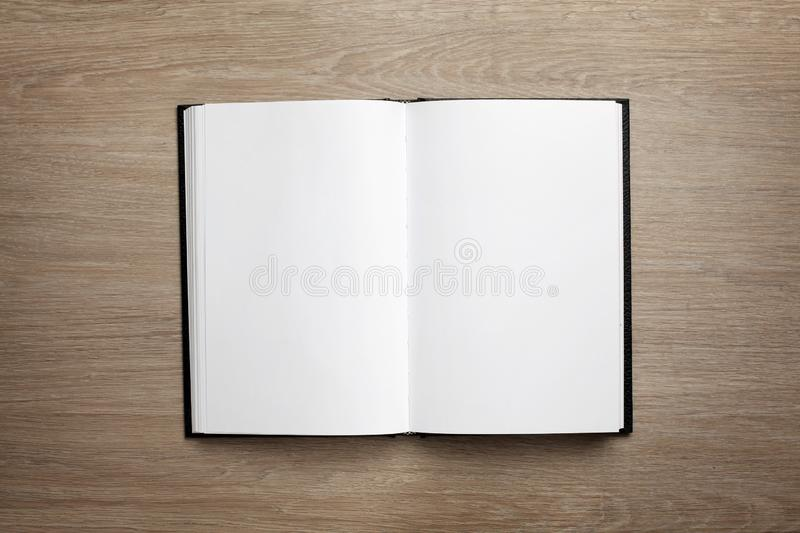Overhead of a open book with blank white pages. Overhead view of a open book with blank white pages royalty free stock photography