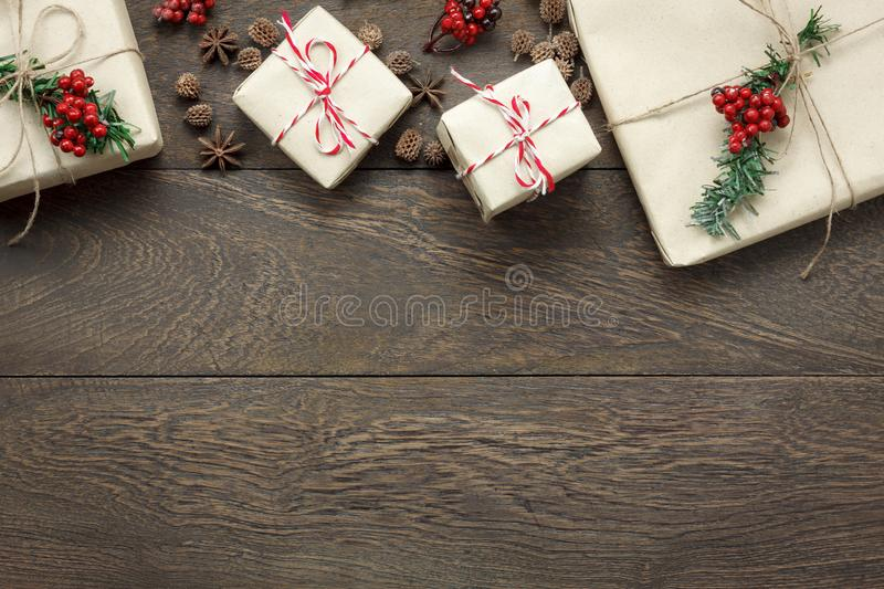 Overhead view of ornaments and decorations Merry Christmas and Happy New Year concept background. Mix several gift box and other object on modern home office royalty free stock photos