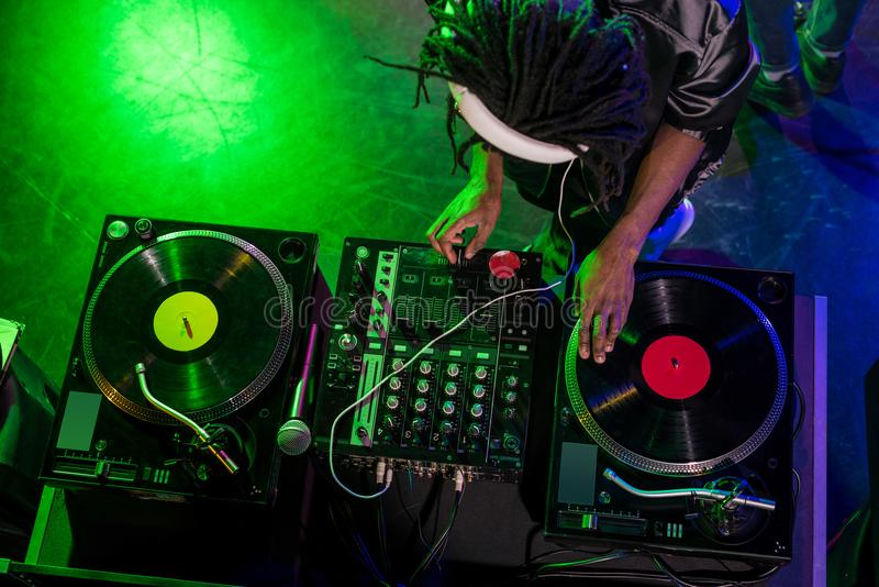 overhead view of professional african american DJ in headphones with sound mixer royalty free stock photography