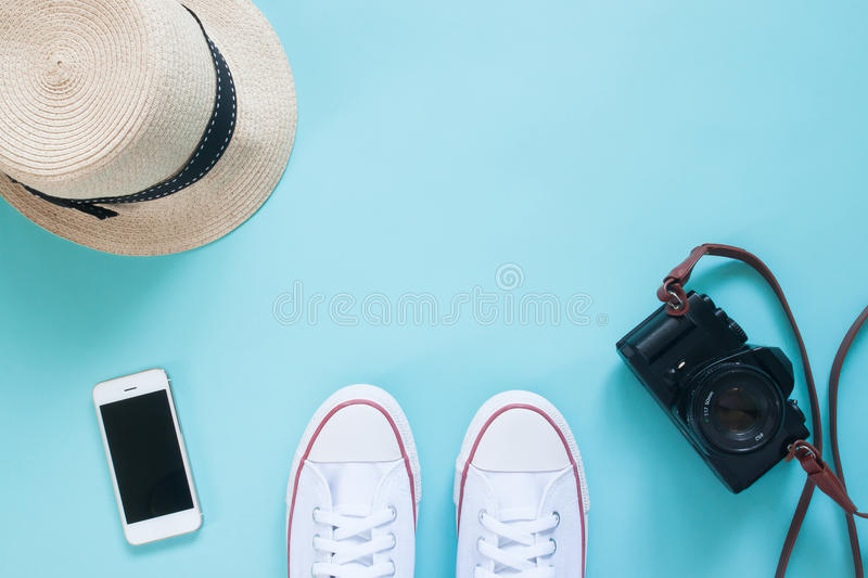 Overhead view selfie of feet in sneakers with smartphone, camera and hat stock photos