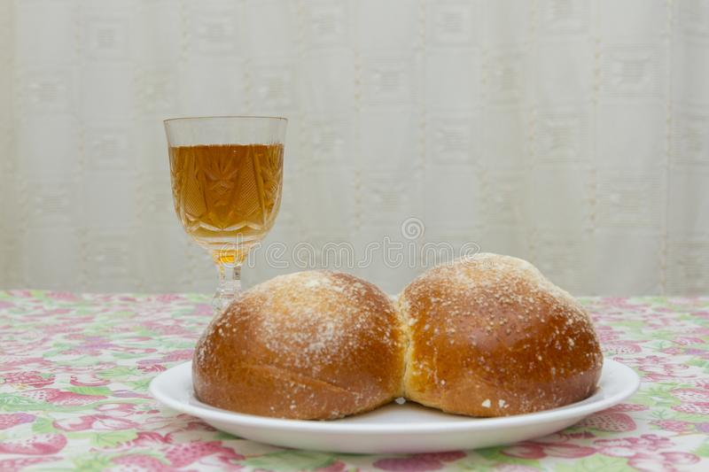 Overhead view of Shabbat eve table with uncovered challah bread and Kiddush wine cup. copy space. Challah and wine on the Sabbath royalty free stock photography