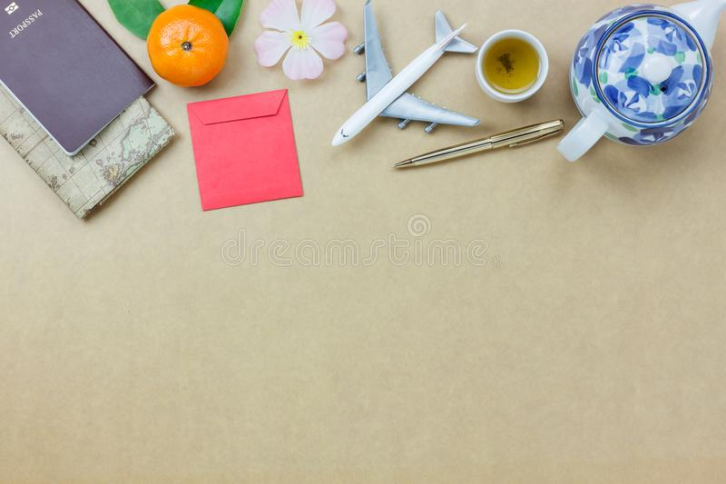 Overhead view shot of essential accessories to travel in Chinese new year & Lunar festival concept. Map & passport and object.Difference items on the modern stock photo